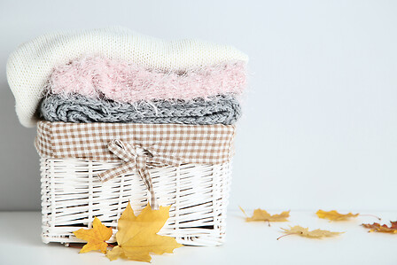 sweater and scarfs in basket