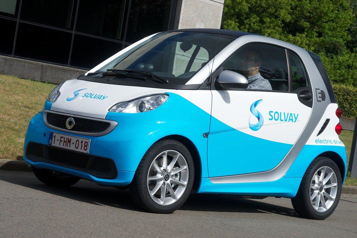 A man driving a electric car