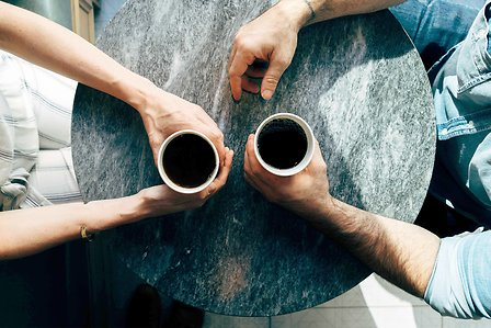 Two persons having a coffee