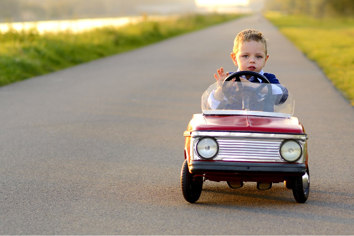 Little boy with red car