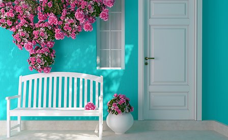 White door on a blue house with roses