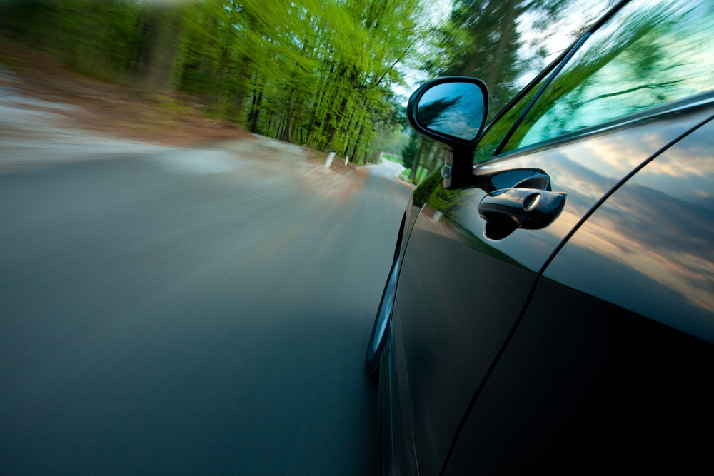 vehicle-with-door-handles-and-rearview-mirrors-driving-in-the-forest