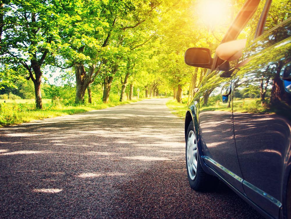 blue-car-on-asphalt-road