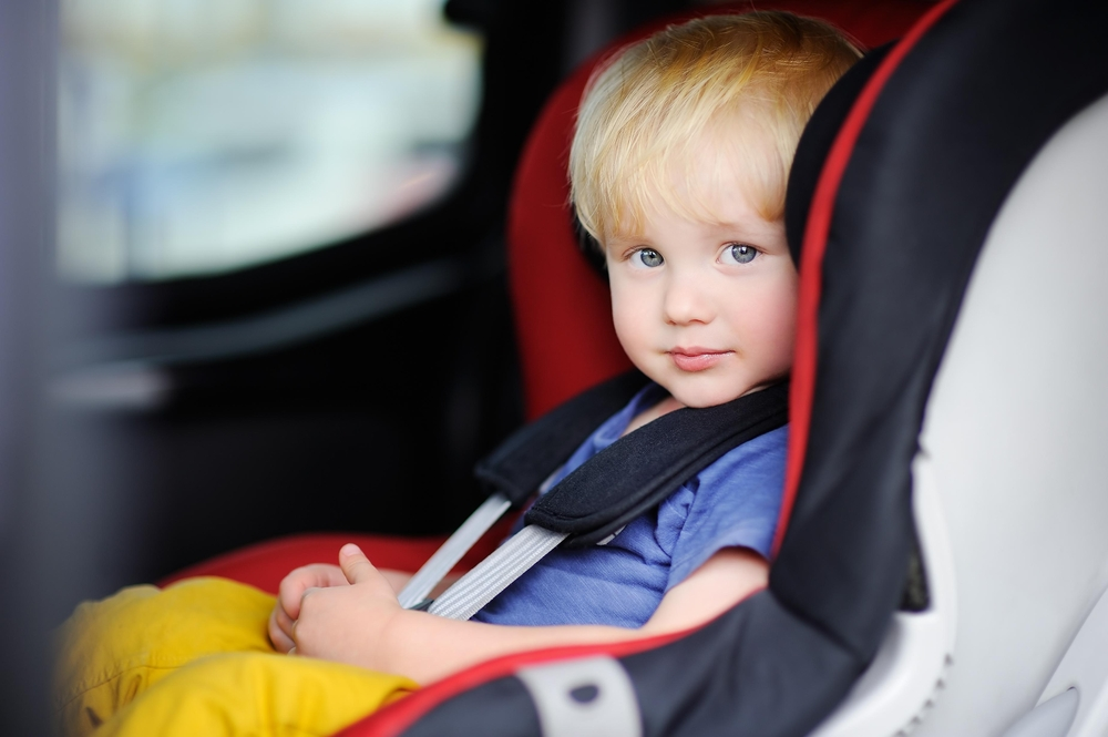 toddler-sitting-in-a-child-car-seat