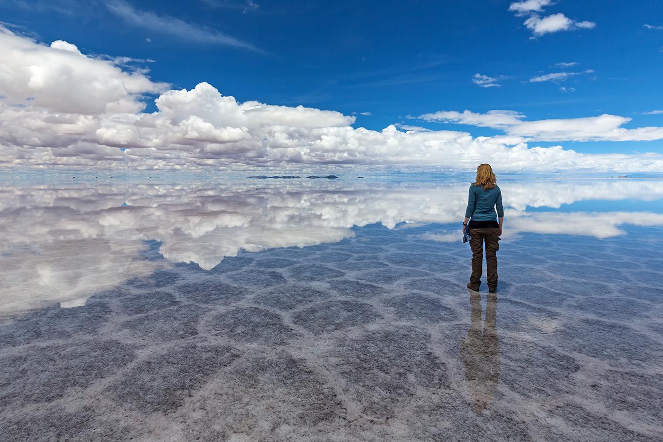 Environmental footprint - woman on lonely beach