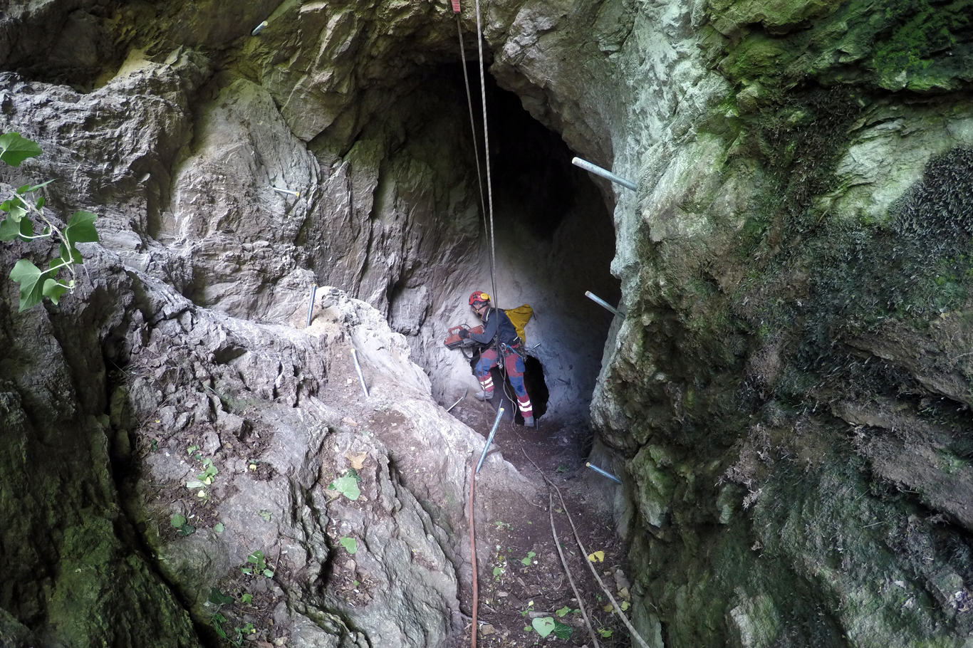 Alpine Climbers at a cave