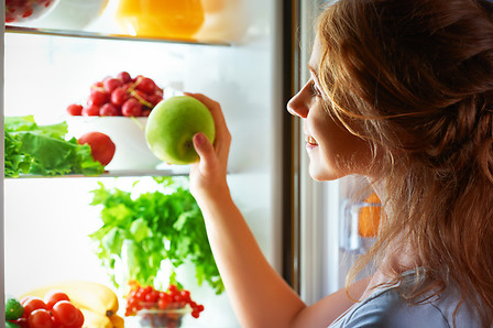 Fruit and vegetables into refrigerator