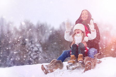 Mother and daughter on sled - MAMME HP