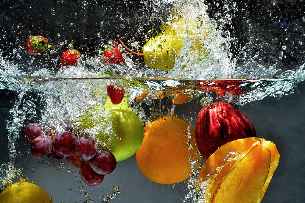 Washing fruits into water
