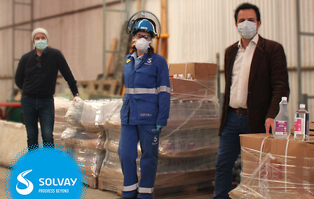 Solvay factory working with masks